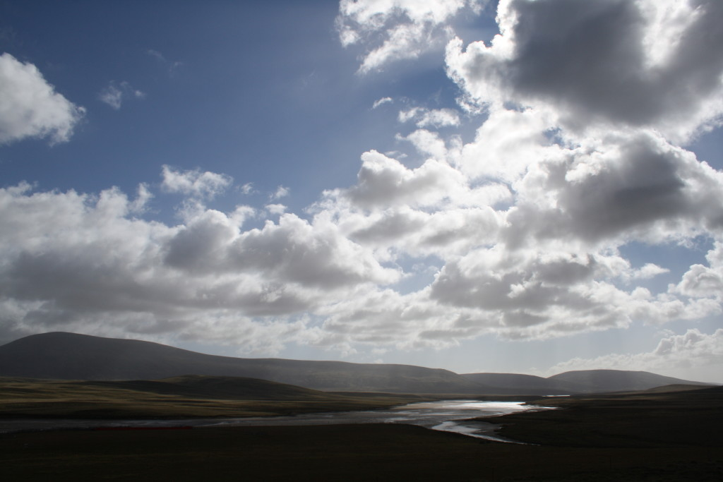 Late afternoon sun picks out a river course on West Falkland.