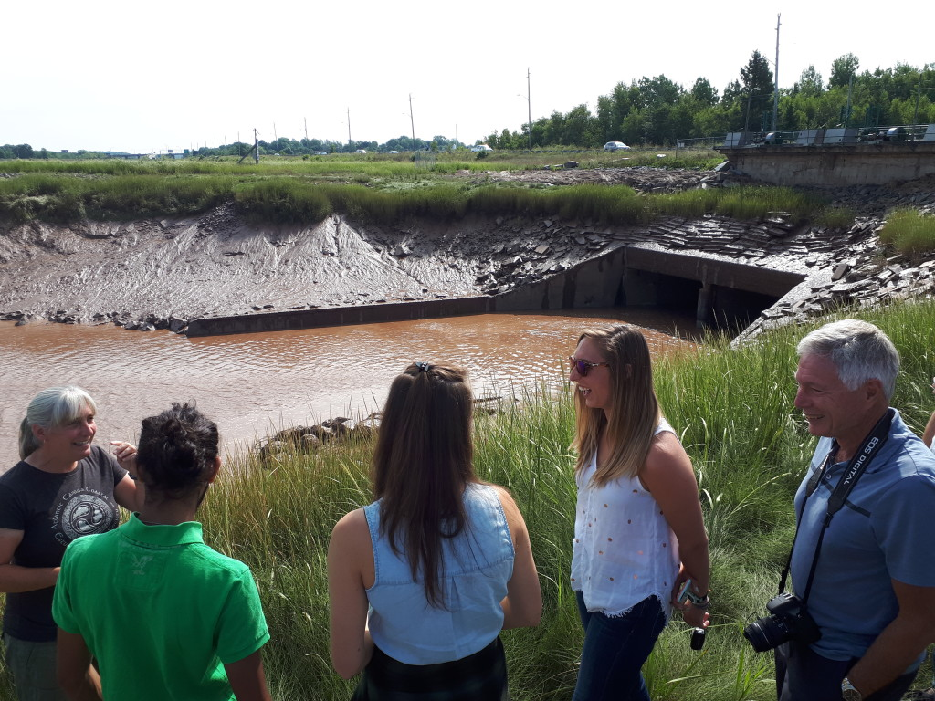 Danika with Guelph students and professor Robin Davidson-Arnott, at the Windsor causeway tidegate.
