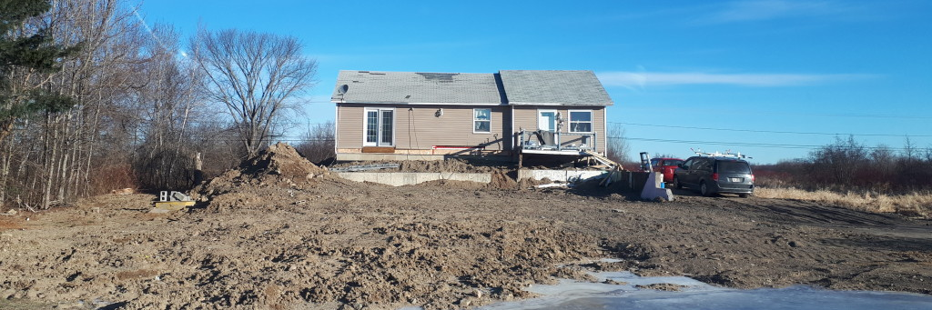 Based on the amount of land disturbance, this house may have been moved back as well as up. Rte 105, Dec 26, 2018.