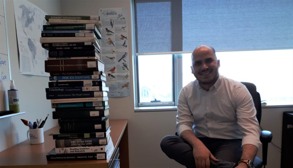 Wes Tourangeau's last day, with a pile of library books to return.