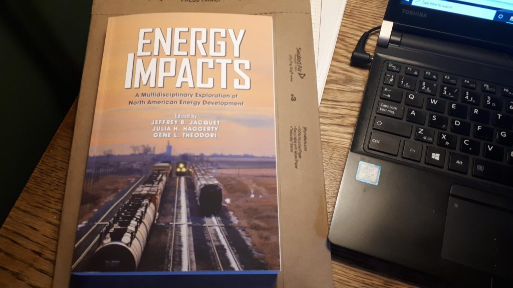 The long-awaited Energy Impacts volume on my home office desk.